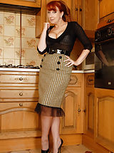 Secretary Pics: Redhead bombshell looking very 'sweater girl' in her clingy top and tight pencil skirt, Red gets it on to reveal her voluptious curves. Soon she's on the floor showing off a smart pair of taupe 60's Brit point heel nylons in a a mix of tease and explicit