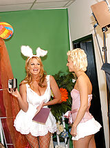 Between Her Legs, Kelly and Christine take turns hopping up and down on the Easter bunnies cock.
