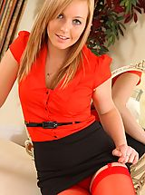 Busty Secretary, The lovely Claire Louise in a black miniskirt