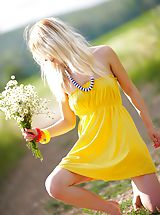 Stunning blonde cutie starts with posing in yellow dress then gets rid of it very willingly