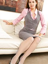 Sexy Secretaries, Michaela in cute pink and grey work outfit.