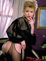 lingerie sexy, Beautiful blonde Brittany Shaw gets cumfy cozy on a silk bed in sexy black crotchless stockings.