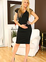 Hot Legs, Only Secretaries, Sexy blonde wearing black dress and white stockings.