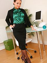 Secretary Pics: Gorgeous brunette Carla shows off the stunning body beneath her office clothes.
