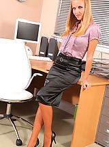 Cheeky blonde secretary relaxes after a hard day in the office by stripping down to just her stockings.
